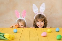 Funny kids wearing Easter bunny. Children having fun at home. Spring holidays concept stock photo