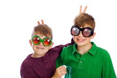 Funny kids wearing novelty glasses. Two funny boys wearing novelty glasses Stock Images