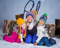 Funny kids in winter clothes Royalty Free Stock Image