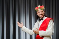 Funny king wearing crown in coronation concept. The funny king wearing crown in coronation concept stock images