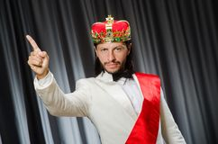 The funny king wearing crown in coronation concept. Funny king wearing crown in coronation concept royalty free stock photography