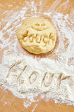 Funny knead dough and flour on wooden table with text Royalty Free Stock Images