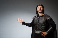 Funny knight against Royalty Free Stock Photography