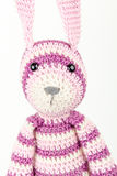 Funny knitted rabbit toy headshot portrait on white Royalty Free Stock Photos