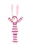 Funny knitted rabbit toy is jumping, isolated Stock Images