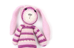 Funny knitted rabbit toy portrait over white wall Stock Photos