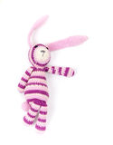 Funny knitted rabbit toy showing right direction Royalty Free Stock Photos