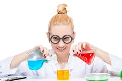Funny laboratory assistant chemist mixes fluids. In test tubes royalty free stock photos