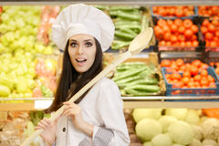 Funny Lady Chef with Big Spoon Shopping for Vegetables Royalty Free Stock Photo