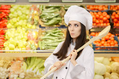 Funny Lady Chef with Big Spoon Shopping for Vegetables Royalty Free Stock Images