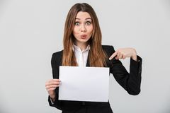 Funny lady grimacing and pointing at white sheet isolated Royalty Free Stock Photos