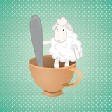 Funny lamb. Over green background Stock Photo