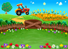 Funny landscape with tractor and cornfield royalty free stock photography