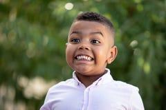Adorable latin child in the garden stock photo