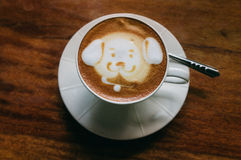 Funny latte. Coffee latte with a funny dog art Stock Images