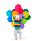Funny laughing baby playing with party balloons Stock Image