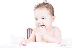 Funny laughing baby waiting for lunch Royalty Free Stock Image