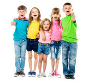 Funny laughing children embracing each other with thumbs up Royalty Free Stock Photography