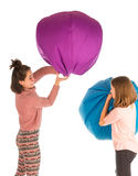 Funny laughing girls fighting with beanbag chairs Royalty Free Stock Photography