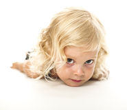 Funny lay down blonde kid Stock Images