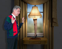 Funny Leg Lamp Christmas Story. A man is excited to have his new leg lamp. A funny scene from the Christmas Story movie. The man is wearing an ugly sweater Stock Photos