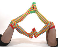Funny legs. Legs of two young woman in funny stockings Royalty Free Stock Image