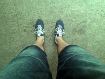 Funny legs. Blue sneakers on funny legs and short pants Royalty Free Stock Images