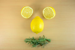 Funny lemons and rosemary Royalty Free Stock Photo