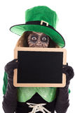 Funny Leprechaun holding a slate with copyspace,  on whi Royalty Free Stock Image
