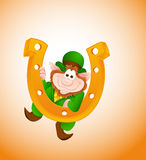 Funny Leprechaun with Horseshoe Stock Photo