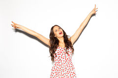 Funny lifestyle portrait of crazy girl, emotional and happy mood, having fun, chic clothes and summer dress. Shows sign Victory. S Stock Images