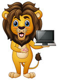 Funny lion cartoon presenting a laptop Royalty Free Stock Photography