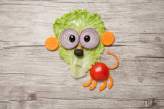 Funny lion made of vegetables on wooden table royalty free stock photography
