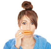 Funny lip enhancement. Woman with sausages simulating lip enhancement she's dreaming of filler injection royalty free stock photography
