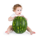 Funny little baby with a big watermelon Stock Photo