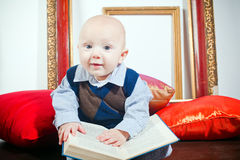 Funny Little Baby With Book Royalty Free Stock Image