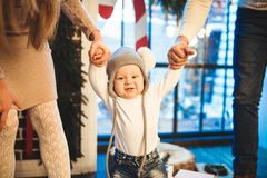 Free Funny Little Baby Boy 1 Year Old Learning Walk Home In Winter In A Decorated New Year House. Young Family Dad And Mom Hold By The Royalty Free Stock Photos - 157946148