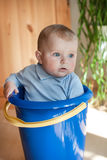 Little baby boy in blue bucket indoor Stock Images