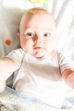 Funny little baby boy taking a selfie Royalty Free Stock Images