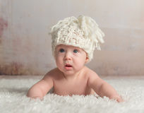Funny little baby crawling on woolen blanket Stock Image