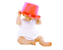 Funny little baby in hat. Playing Stock Images