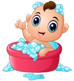 Funny little baby having bath with soap foam in a bathtub Stock Images