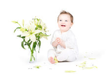 Funny little baby with lily flowers Royalty Free Stock Photo