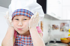 Funny little baker grimaces Stock Photography