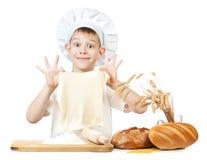Funny little baker is kneading dough Stock Photos