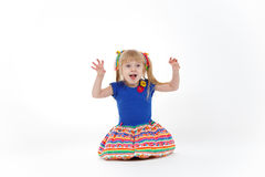 Funny little blond girl with two tails imitating cat Stock Photos