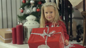 Funny little blonde girl with long hair sitting stock footage