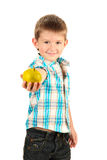 Funny little boy with apple Royalty Free Stock Photography