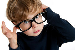 Cute Boy with Big Glasses. Funny little boy with big glasses shot in the studio on a white background Royalty Free Stock Photo