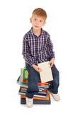 Funny little boy with books Royalty Free Stock Photos